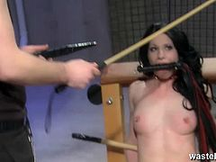 This is some hardcore bdsm session you can see for this brunette babe who want to please her young master. She was naked and tied up at the chair got spanked and toyed.
