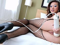 Have fun watching this Asian brunette, with a nice ass wearing fishnet stockings, while she goes hardcore with a horny dude and plays with big toys.