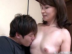 Sexy mature Japanese Yuuri Saejima surprises this guy jerking off and gives him a little help by riding his hard cock until getting jizzed.