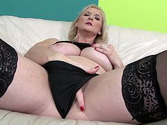 Check this blonde mature lady, with giant knockers wearing nylon stockings, while she goes hardcore with a giant black pole over a couch.