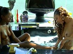 Two randy ebony lesbian babes with natural fits play around in the jacuzzi before licking pussy. Curvy chick also gets toes in cunt and nails painted