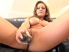 Mind blowing goddess demonstrates her big appetizing boobs and rubs her dripping wet poontang. Then she bends over and pokes her cunny with a dildo.