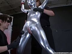 She got some punishment for not being obedient to her masters and got wrapped in a full silver bodysuit and got tied up toying her privates with the magic wand.