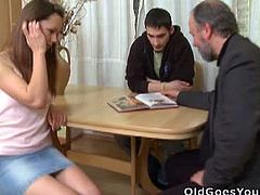 Old Goes Young brings you a hell of a free porn video where you can see how this horny old man pounds a sexy brunette teen while assuming very hot poses in front of her boyfriend.