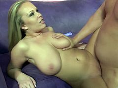 Take a look at Jessica Moore's huge natural breasts in this hardcore scene where this busty blonde is eaten out and fucked by a guy.