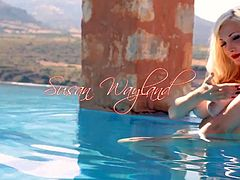 Susan Wayland sexy latex strip by the pool