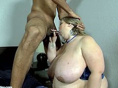 There's nothing that a moist Mandy Majestic wants more than to shove a cock in her mouth. Luckily her date has the same thing in mind. He invites her in to his bedroom and proceeds to grope and grab everything in site, her humongous tits, her large ass, her round belly, it's all good. Time to tax that ass, as her date givers her a dose of big black dick, that Ms. Majestic won't soon forget.