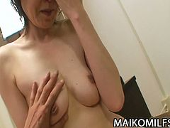 Japanese brunette mature Takako Kumagaya gets banged very hard into a massive orgasm while assuming some very interesting poses in this free porn video set by Maiko Milfs.