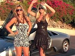 Gorgeous blonde lesbians with long hair pose besides their marvelous cars then remove their big tits before sucking them passionately