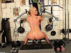 Blonde woman Kathia Nobili does striptease before she sticks her fingers in her cunt