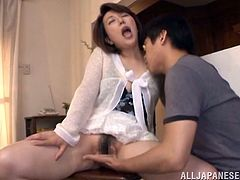 Have a blast watching this Japanese wife, with a nice ass wearing a miniskirt, while she gets touched by her dirty husband in a reality video.