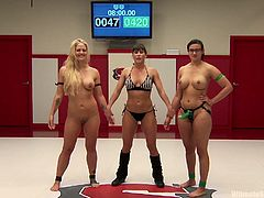If you're into the tough type of bitches, you'll surely appreciate these scenes, that take place in the wrestling arena. The blonde milf is clearly being dominated by her brunette opponent. The naked slut with glasses wears a strap on, which efficiently does its job, while the blonde is fucked from behind. See!