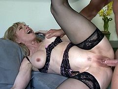 Have a look at this amazing hardcore scene where the sexy mature Nina Hartley sucks on this stud's big cock before being fucked while wearing stockings.