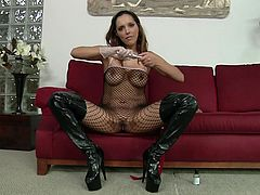 Click to watch this brunette cougar, with big tits wearing a fishnet outfit, while she shows you how to uses this wicked toys in a dirty way.