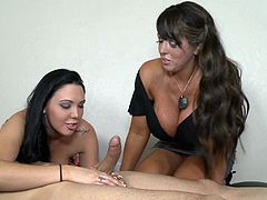 Well-endowed brunettes Megan Foxx and Alura Jenson are having fun with a dude indoors. The women show their blowjob and handjob skills to the guy and seem to enjoy themselves.