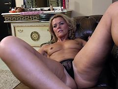 This hot milf feels kinda lonely. She is lying on her couch and starts touching her own nipples. She takes her black nylon panties off and spreads her beautiful legs in order to rub that wet cunt of hers. She touches it with gentle moves while she moans of pleasure. Will she have an orgasm?