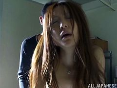 Horny Asian babe is fucked in an office by a guy