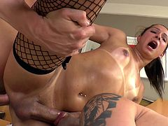 Go wild as you watch this brunette shemale, with small tits wearing fishnet stockings, while she goes hardcore with two dirty fellows.