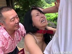 Get excited by watching this Asian brunette, with natural boobs wearing a skirt, while she goes hardcore in a wild threesome outdoors.