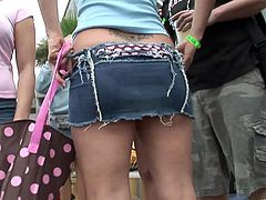 Amazing Party dolls in blue jeans and miniskirts parties together with their counterparts in bikinis in a outdoor event