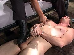 A hot stud has been put in jail. He cannot pass unnoticed, so he receives the officer's visit. His hands are in shackles. See him obeying every kinky command. The long-haired guy begins to suck a shaved dick. Kip seems to be very passionate. Click to watch both of them get excited and really horny!