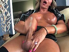 Horny blonde tranny Ariel Everitts, wearing a cop uniform, is getting naughty in the living room. She shows her big boobs and dick and pleases herself with masturbation.