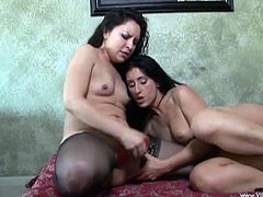 Horny lesbian babes Luscious Lopez and Eva wear sexy black stockings while they get a good taste of each other's delicious pussies.
