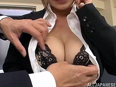 Pretty Japanese secretary Kaho Kasumi does everything what her boss tells her to. This time the dude asks Kaho to play with his dick. The girl obeys and pleases the guy with a blowjob and a titjob.
