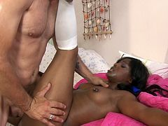 Ebony cheerleader sucks a big cock before being fucked