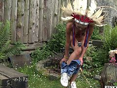 Pinky is out in her backyard dressed up as an Indian chief. She spreads her legs open wide and sticks her fingers into her pussy. She sticks the whole palm of her hand and all of her fingers into her wet vagina.