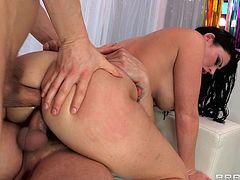 Curvy brunette Sophie Dee, wearing a bikini, shows her big boobs and nice ass to Erik Everhard and Mr. Pete. The studs face-fuck Sophie, then double penetrate her and use her face as a cum target.