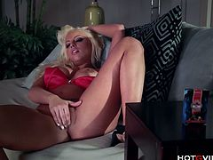 Busty blonde whore solo orgasm show.The elegant, busty blonde, Brittney Amber, delights in a little nighttime masturbation using her favorite toy to satisfy her dirty desires.