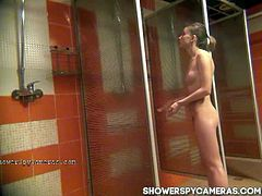 Sexy amateur teenie is ready to gom home after an exhausting swimming training. She is all naked and rubs her young body, without knowing about the secret camera.
