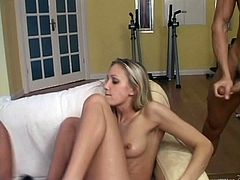 A gorgeous teen with long blonde hair, small tits and a skinny body enjoys a hardcore threesome fuck on her coffee table.