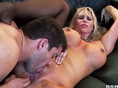 Big-breasted blonde mom Karen Fisher gives a blowjob to Ramon and lets him drill her twat doggy style. After that she shows her titjob skills to the man.