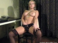Hot blonde Malina May, wearing a miniskirt and stockings, is playing dirty games in an office. Malina strips and plays with her massive natural boobies, then fingers her snatch and moans sweetly.