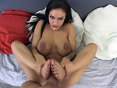 Tattooed brunette Angelina Valentine pleases a guy with a hot blowjob. After that she enjoys banging in the reverse cowgirl pose and massages the boner with her feet afterwards.