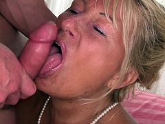 Voracious bitch wearing black stockings sucks hard dick and gets her cunt banged doggystyle. Then she rides stiff prick on top and gets pounded in a sideways pose.