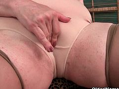 Lisa is a mature lady who has urges too. She squeezes her huge boobs before she rubs her shaven pussy. She does this at home and at work, where she is a nurse.