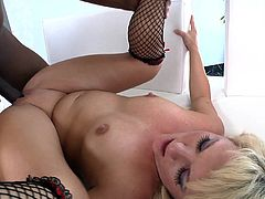 The gorgeous blonde babe Casey Cumz gets a yummy cumshot in her mouth after taking a huge black cock up her tight little asshole.