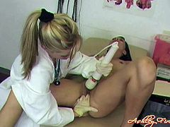 A brunette chick comes to a gynecologist to get her pussy examined. The doctor stuffs the chick's cunt with a vaginal speculum, after that they make hot lesbian love.