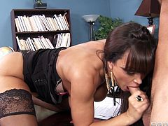 A sizzling hot cougar with long dark hair, big gorgeous tits and an awesome body enjoys a hardcore anal fuck in her office.