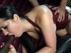 Sizzling brunette Angel Summer, wearing a corset and stockings, is getting naughty with two studs indoors. The men fuck Angel's pussy and bumhole doggy style and in the reverse cowgirl position and enjoy the way she moans.