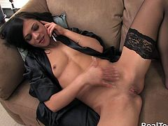 Slim brunette bombshell Mandy, wearing stockings, is talking on the phone in the living room. The cutie strokes her small tits passionately, then fucks her shaved pussy with a dildo.