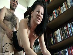 Have a look at this hardcore scene where the sexy brunette milf Mina Gorey is fucked by this guy in his office as you hear her moan.