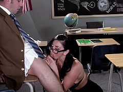 Alluring teacher with big fake tits in high heels and stockings giving an arousing tit job then gets her shaved pussy rammed doggy style