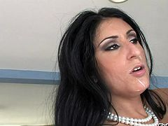 Big booty brunette in white fishnets displays her hot ass before giving her dude a superb blowjob till the he cums in her mouth