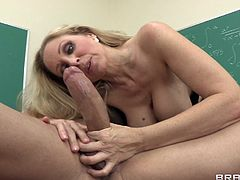 A beautiful blonde teacher with long hair, massive fake tits and a fabulous body enjoys a hardcore fuck in her classroom.