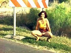Take a look at this vintage video where this horny brunette pulls up her skirt in public and squats down to take a piss.