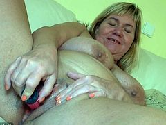 Get a hard dick by watching this blonde mature lady, with giant jugs and a shaved pussy, while she goes hardcore with a chick using a strapon.